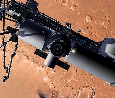 Auf diesem Foto sieht man einen Ausschnitt vom Weltall mit dem Mars. Vor der Oberfläche des Mars fliegt ein Satellit. Der Satellit ist im Vordergrund des Bildes zu sehen und verdeckt teilweise die rotbraune Marsoberfläche. Dies ist eine der virtuellen Welten beim VR-Schnorcheln im Nettebad Osnabrück.